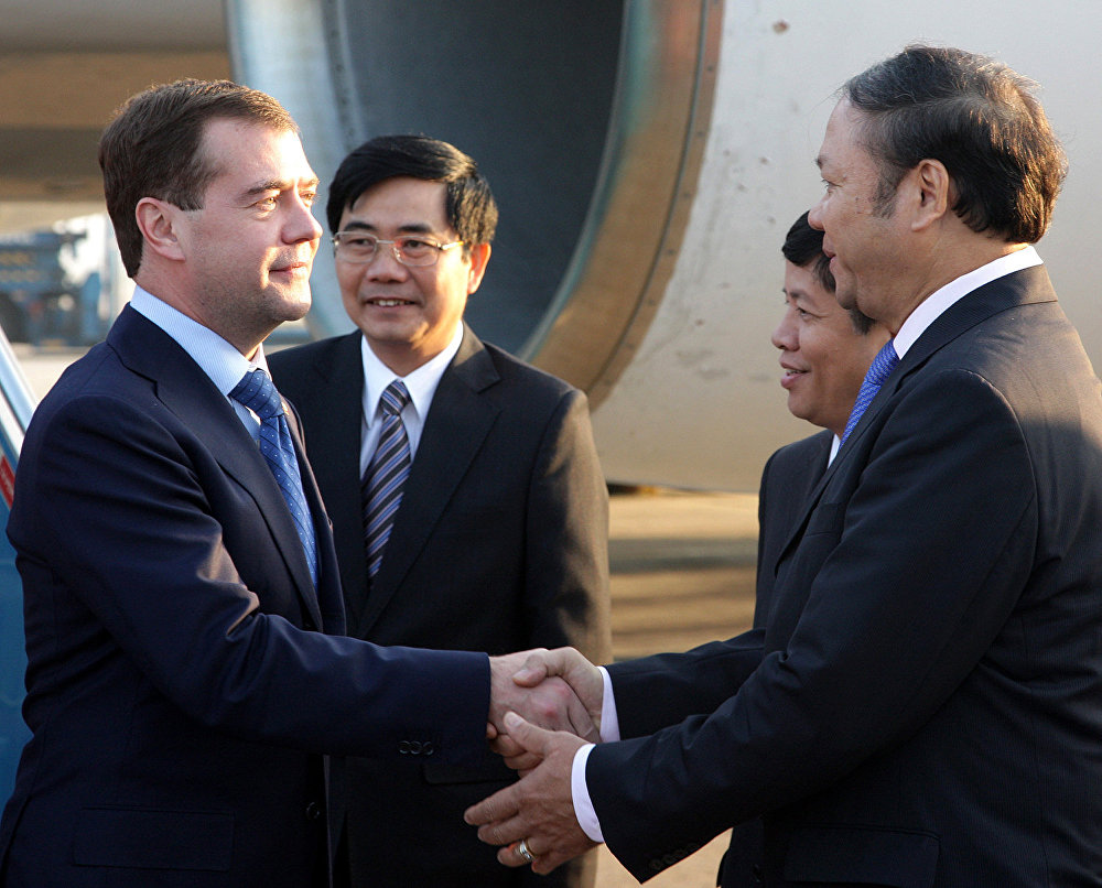 Russian President Dmitry Medvedev (left in the foreground), arriving to attend the Second ASEAN – Russia Summit, during a welcoming ceremony at the Hanoi Airport. On the right in the foreground is Ambassador Extraordinary and Plenipotentiary of the Socialist Republic of Vietnam to Russia Bui Dinh Dinh.